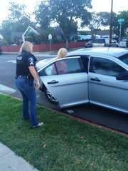 Blanca Landeros gets in the police car